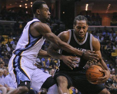 Apr 24, 2016; Memphis, TN, USA; San Antonio Spurs forward Kawhi Leonard (2) handles the ball against Memphis Grizzlies guard Tony Allen (9) during the first half in game four of the first round of the NBA Playoffs at FedExForum. Mandatory Credit: Justin Ford-USA TODAY Sports / Reuters Picture Supplied by Action Images