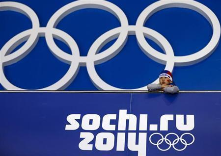 A young Russian fan watches the women's preliminary round ice hockey game between Germany and Sweden during the Sochi 2014 Winter Olympics Games February 11, 2014. REUTERS/Shamil Zhumatov