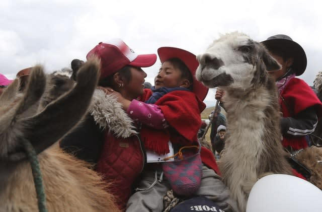 A mother embraces her child after the race (Dolores Ochoa/AP)