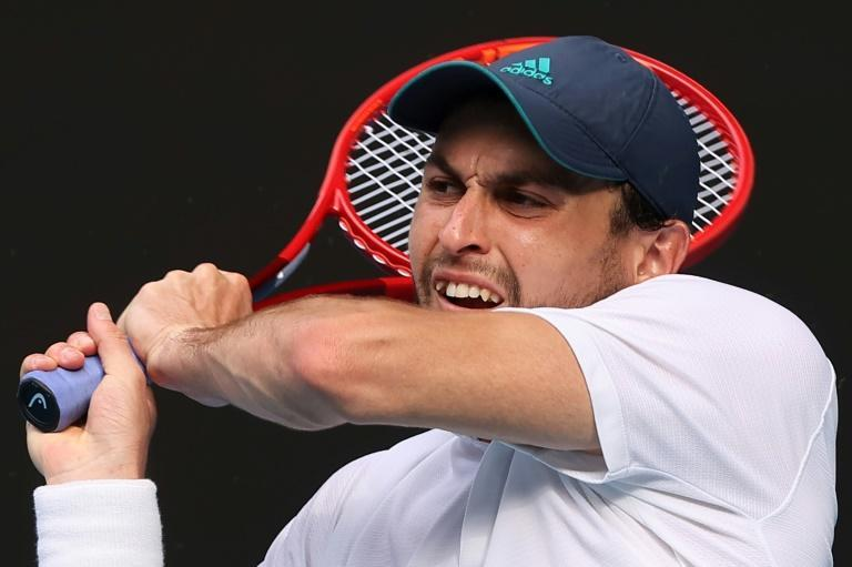 Firepower: Russia's Aslan Karatsev hits a return against Grigor Dimitrov during their quarter-final