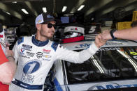 Kyle Larson fist bumps a member of his crew after qualifying in pole position for the NASCAR Cup Series auto race at Charlotte Motor Speedway on Saturday, May 29, 2021 in Charlotte, N.C. (AP Photo/Ben Gray)