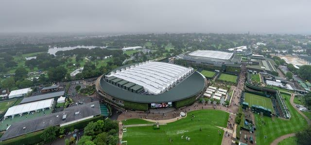 The roofs were on Centre Court and Court One as poor weather marked the start of Wimbledon