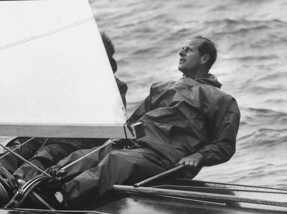 <p>Prince Philip at helm of his yawl, Bloodhound, during Cowes Regatta in July 1962.</p>