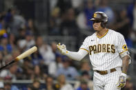 San Diego Padres' Manny Machado tosses his bat after striking out during the third inning of the team's baseball game against the Los Angeles Dodgers, Wednesday, Aug. 25, 2021, in San Diego. (AP Photo/Gregory Bull)