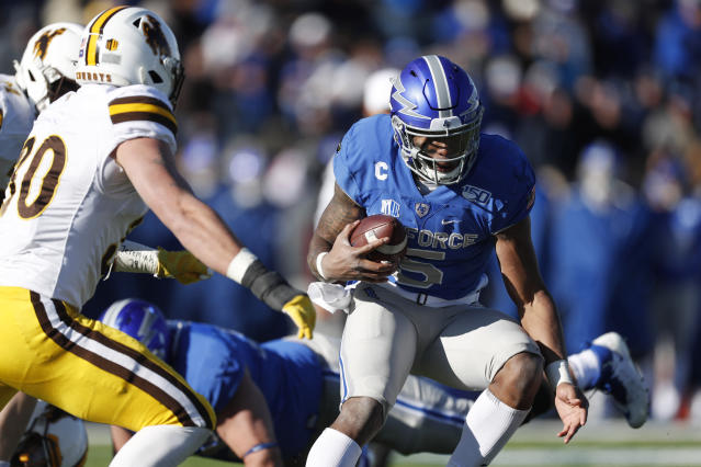 Air Force quarterback Donald Hammond III, right, runs for a short gain as Wyoming linebacker Logan Wilson comes in to make the tackle in the second half of an NCAA college football game Saturday, Nov. 30, 2019, at Air Force Academy, Colo. Air Force won 20-6. (AP Photo/David Zalubowski)