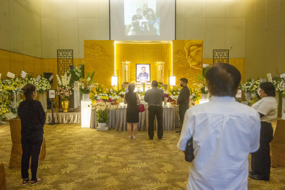 People pay their final respects to Datuk Wong Sai Wan during his wake service at the Xiao En centre in Kuala Lumpur May 16, 2021. — Picture by Shafwan Zaidon