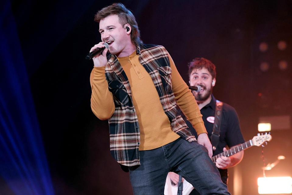 <p>Morgan Wallen performs at the Ryman Auditorium on Tuesday in Nashville.</p>
