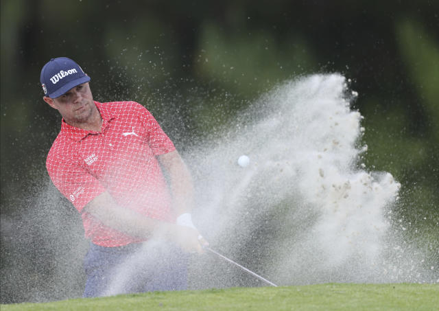 Gary Woodland of United States hits from the bunker at the 17th hole during the final round for the WGC-Mexico Championship golf tournament, at the Chapultepec Golf Club in Mexico City, Sunday, Feb. 23, 2020.(AP Photo/Fernando Llano)