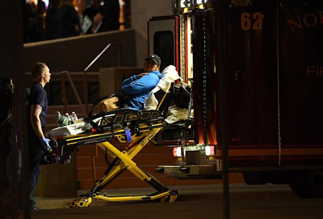 <p>A witness is loaded into an ambulance, after she and others were taken to Thornton Civic Center, preceding a shooting inside the Walmart Super Center, Nov. 1, 2017 in Thornton, Colo. (Photo: RJ Sangosti/The Denver Post via Getty Images) </p>