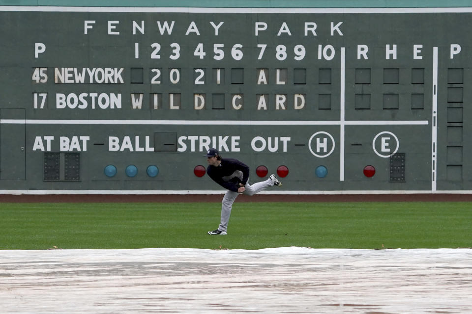 New York Yankees starting pitcher Gerrit Cole throws in the outfield during the American League Wild Card Workout Day at Fenway Park, Monday, Oct. 4, 2021, before Tuesday's American League Wild Card game against the Boston Red Sox in Boston. (AP Photo/Mary Schwalm)