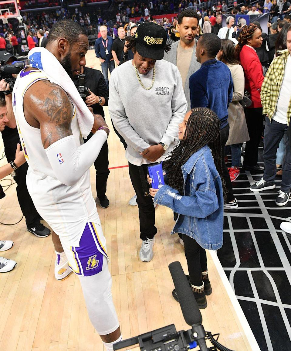 <p>Jay-Z earned some major dad points as he introduces his daughter, Blue Ivy, to NBA star LeBron James after attending a game together in 2020. </p>