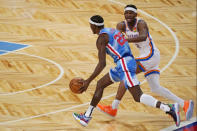 Oklahoma City Thunder guard Shai Gilgeous-Alexander (2) defends against Brooklyn Nets guard Caris LeVert (22) during the first quarter of an NBA basketball game, Sunday, Jan. 10, 2021, in New York. (AP Photo/Kathy Willens)