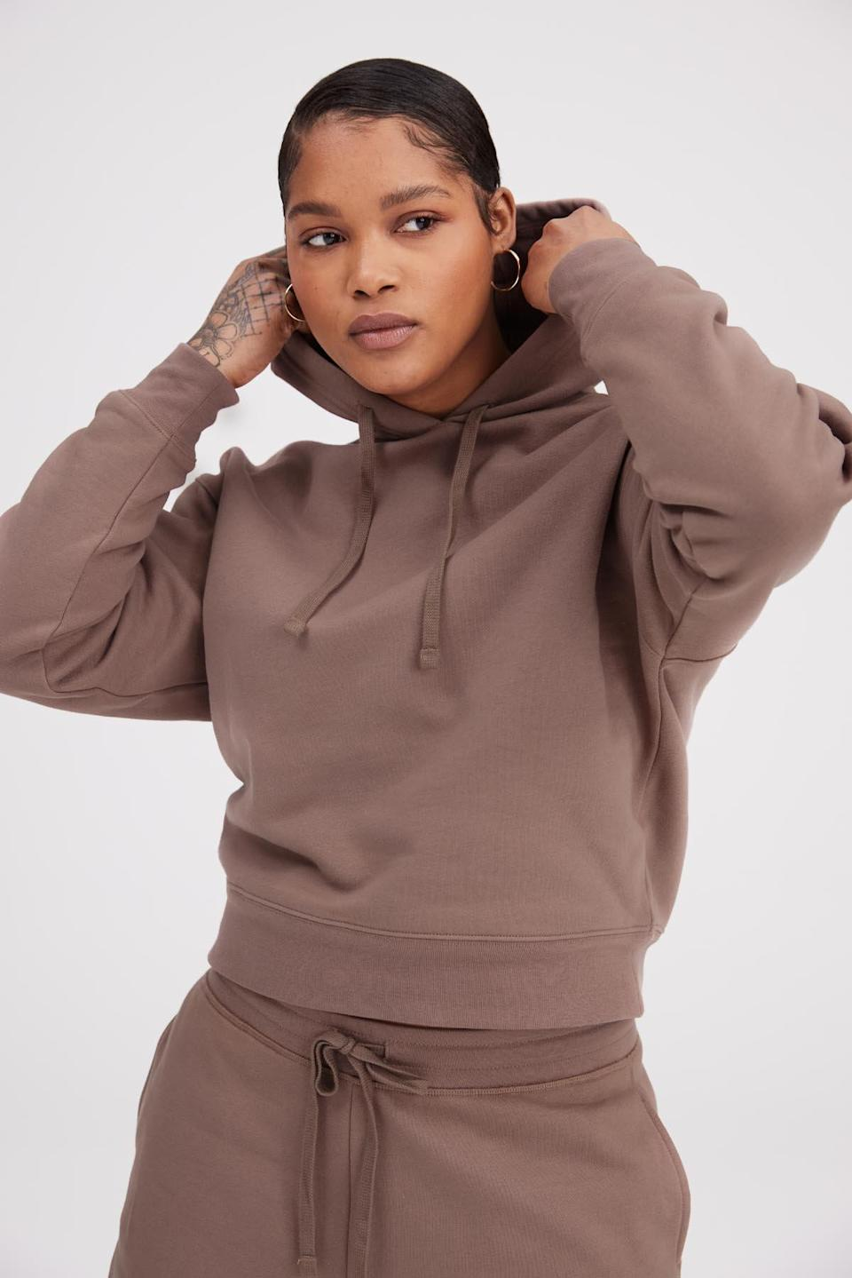 """<h2>Girlfriend Collective Taro Classic Hoodie</h2><br>""""In a perfect world I would want to buy some sophisticated business clothes that make me look like a bonafide professional, but I just want to add to my sweatshirt collection like I do every fall. I do think the lovely Taro hue and the supple sustainable organic cotton make this hoodie a tad more classy than your average sweatshirt (especially if I pair it with matching sweatpants!)."""" <em>– Alexandra Polk, Lifestyle Writer</em><br><br><em>Shop <a href=""""https://girlfriend.com/"""" rel=""""nofollow noopener"""" target=""""_blank"""" data-ylk=""""slk:Girlfriend Collective"""" class=""""link rapid-noclick-resp"""">Girlfriend Collective</a></em><br><br><strong>Girlfriend Collective</strong> Taro Classic Hoodie, $, available at <a href=""""https://go.skimresources.com/?id=30283X879131&url=https%3A%2F%2Fwww.girlfriend.com%2Fcollections%2Fsweatshirts%2Fproducts%2Ftaro-classic-hoodie"""" rel=""""nofollow noopener"""" target=""""_blank"""" data-ylk=""""slk:Girlfriend Collective"""" class=""""link rapid-noclick-resp"""">Girlfriend Collective</a>"""