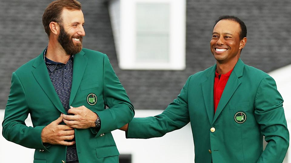 Dustin Johnson is awarded the Green Jacket by Masters champion Tiger Woods after winning the 2020 Masters. (Photo by Patrick Smith/Getty Images)