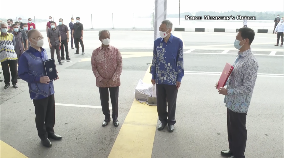(L-R) Malaysia's Transport Minister Wee Ka Siong and Prime Minister Muhyiddin Yassin, alongside Singapore's PM Lee Hsien Loong and Transport Minister Ong Ye Kung SCREENSHOT: PMO Facebook page