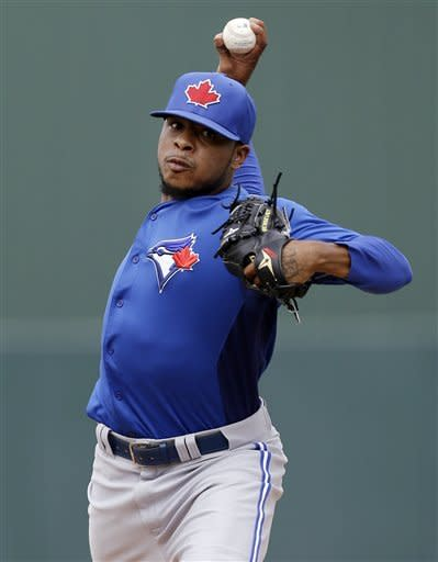 Toronto Blue Jays relief pitcher Jeremy Jeffress delivers to the Minnesota Twins during an exhibition spring training baseball game in Fort Myers, Fla., Sunday, March 24, 2013. (AP Photo/Elise Amendola)