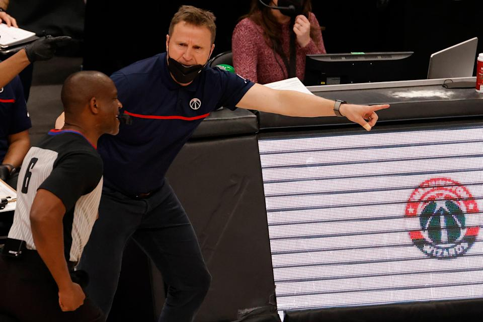 Washington Wizards head coach Scott Brooks argues a call with referee Tony Brown (6) during a game last month in Washington.