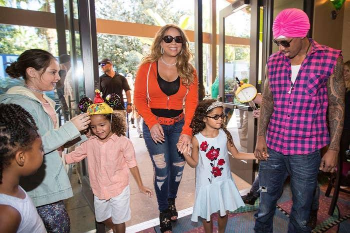 Nick with Mariah and their children