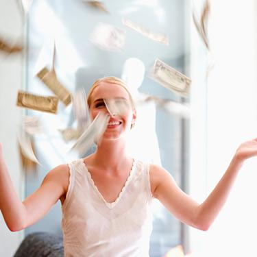 Smiling-woman-with-falling-money_web
