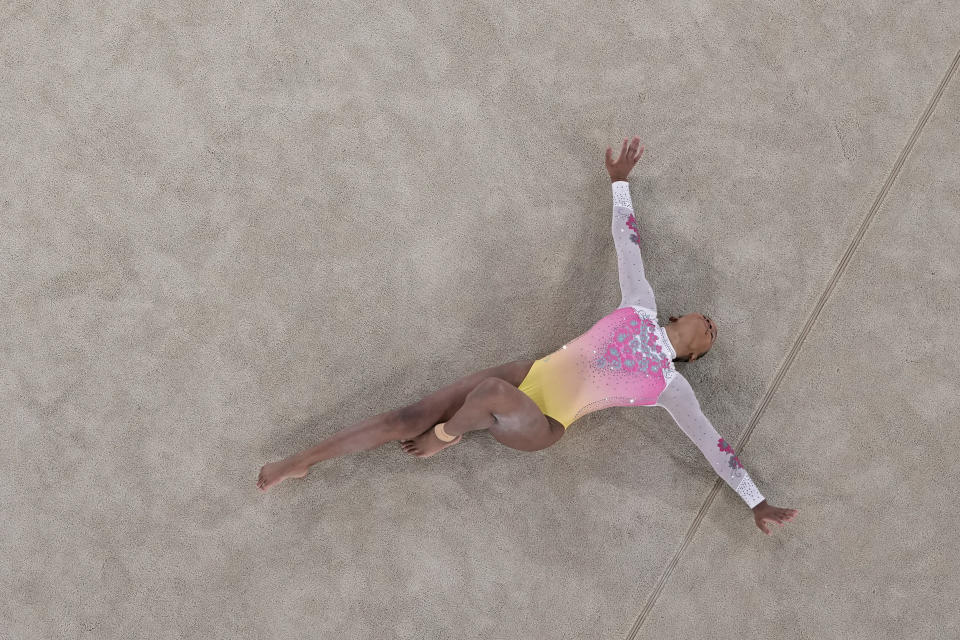 Rebeca Andrade, of Brazil, performs in the floor exercise during the artistic gymnastics women's apparatus final at the 2020 Summer Olympics, Monday, Aug. 2, 2021, in Tokyo, Japan. (AP Photo/Jeff Roberson)