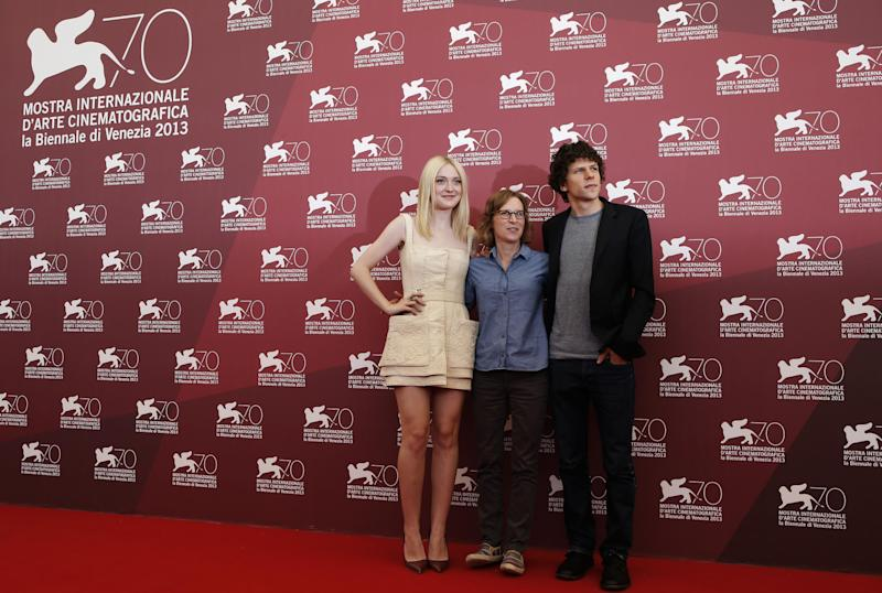 From left, actress Dakota Fanning, director Kelly Reichardt and actor Jesse Eisenberg pose for photographers during the photo call for the film Night Moves at the 70th edition of the Venice Film Festival held from Aug. 28 through Sept. 7, in Venice, Italy, Saturday, Aug. 31, 2013. (AP Photo/David Azia)