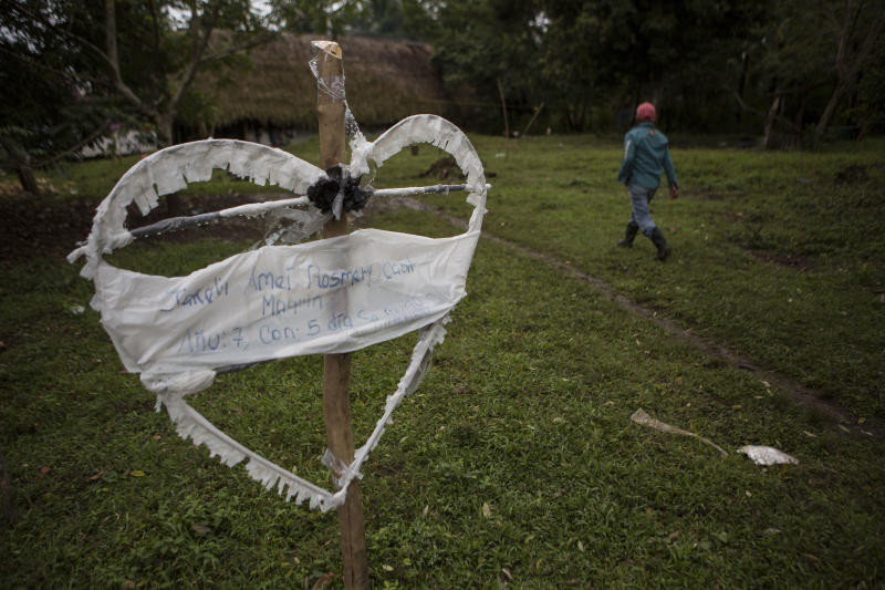 A heart-shaped sign displays the name of Jakelin Amei Rosmey Caal in Raxruha, Guatemala, on Saturday, Dec. 15, 2018. The 7-year-old girl died in a Texas hospital, two days after being taken into custody by border patrol agents in a remote stretch of New Mexico desert. (AP Photo/Oliver de Ros)