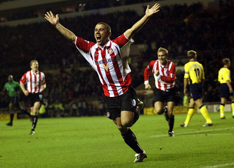 SUNDERLAND - NOVEMBER 10: Kevin Phillips of Sunderland celebrates after scoring the opening goal during the FA Barclaycard Premiership match between Sunderland and Tottenham Hotspur on November 10, 2002 played at the Stadium of Light in Sunderland, England. Sunderland won the match 2-0. (Photo by Michael Steele/Getty Images)