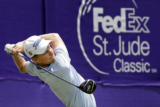 Peter Malnati tees off on the 17th hole during the second round of the St. Jude Classic golf tournament Saturday, June 7, 2014, in Memphis, Tenn. Bad weather on Friday caused the second round to continue into Saturday. (AP Photo/Mark Humphrey)