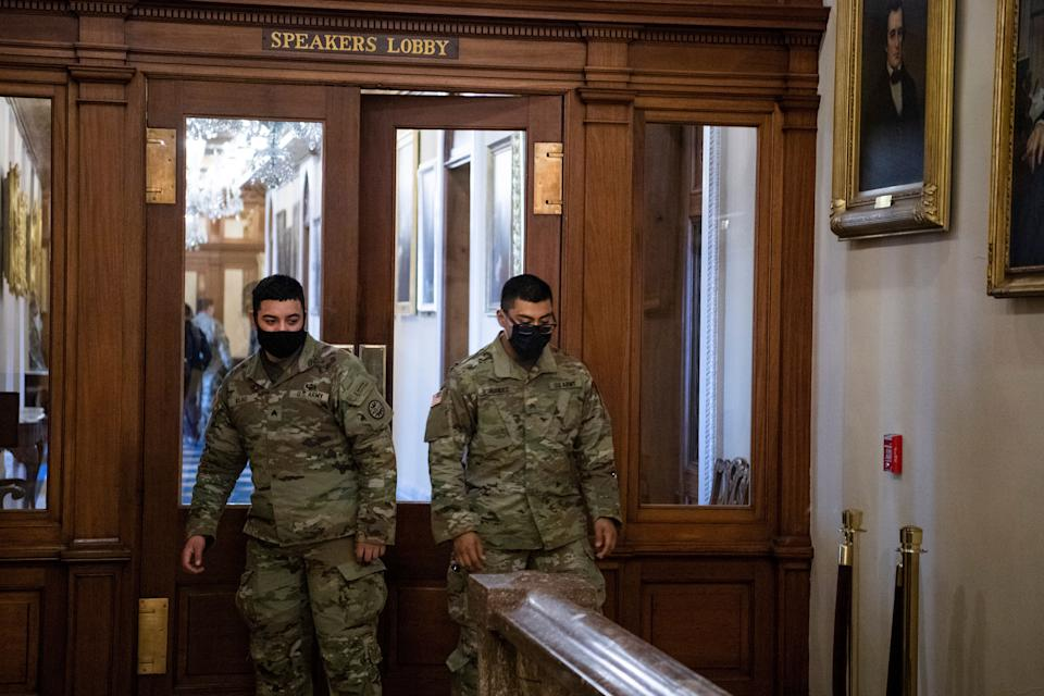 Members of the National Guard are seen in the Speakers Lobby at the door where Ashli Babbitt was killed during the Capitol riot on Jan. 6. (Photo: Tom Williams via Getty Images)