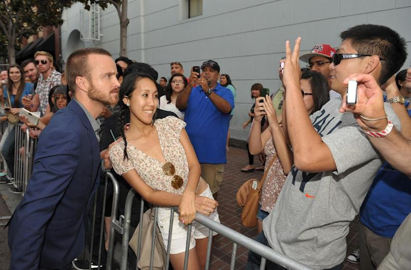"""COMMERCIAL IMAGE - Aaron Paul greets fans at AMC's """"Breaking Bad"""" Premiere and After Party on Saturday, July 14, 2012 in San Diego, CA.(Photo by John Shearer/Invision for AMC/AP Images)"""