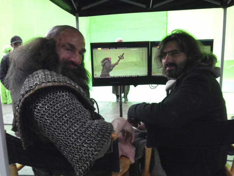 """This Friday, July 26, 2013 photo taken with self-timer and released by Peter Jackson, actor Graham McTavish, left, as Dwalin, stands with director Peter Jackson on the final day of shooting The Hobbit in Wellington, New Zealand. Jackson has wrapped up filming """"The Hobbit"""" trilogy and shared pictures of his last day on the set with his Facebook fans. The New Zealand filmmaker provided a steady stream of updates and photos from the set of the final film, """"The Hobbit: There And Back Again,"""" on Friday, July 26. The second film, """"The Hobbit: The Desolation of Smaug,"""" will be released in December, and the finale appears in 2014. (AP Photo/Peter Jackson) MANDATORY CREDIT(AP Photo/Peter Jackson) MANDATORY CREDIT"""