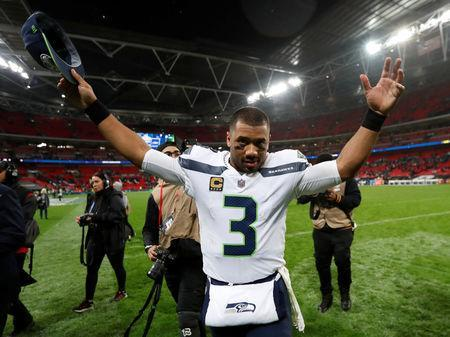 FILE PHOTO: NFL Football - Seattle Seahawks v Oakland Raiders - NFL International Series - Wembley Stadium, London, Britain - October 14, 2018 Seattle Seahawks' Russell Wilson celebrates after the match Action Images via Reuters/Paul Childs/File Photo
