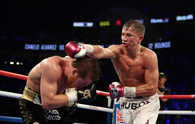 Gennady Golovkin punches Canelo Alvarez during their WBC/WBA middleweight title fight at T-Mobile Arena on Saturday in Las Vegas. (Getty Images)