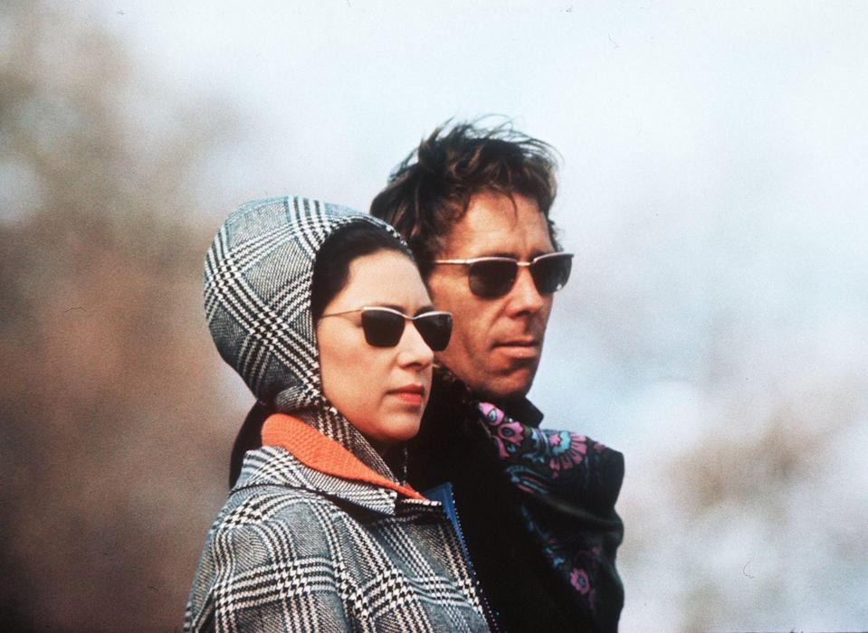 <p>Margaret and Lord Snowdon in similar sunglasses. </p>