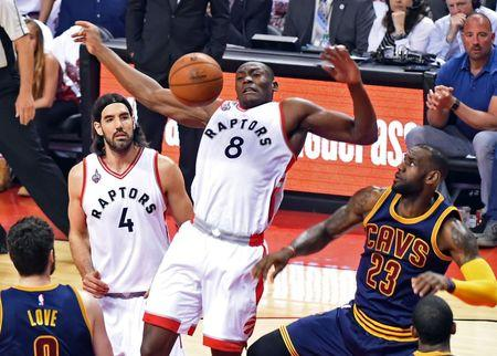 May 23, 2016; Toronto, Ontario, CAN;  Toronto Raptors center Bismack Biyombo (8) goes up for a rebound above forward Luis Scola (4) and Cleveland Cavaliers forward LeBron James (23) in game four of the Eastern conference finals of the NBA Playoffs at Air Canada Centre. Mandatory Credit: Dan Hamilton-USA TODAY Sports
