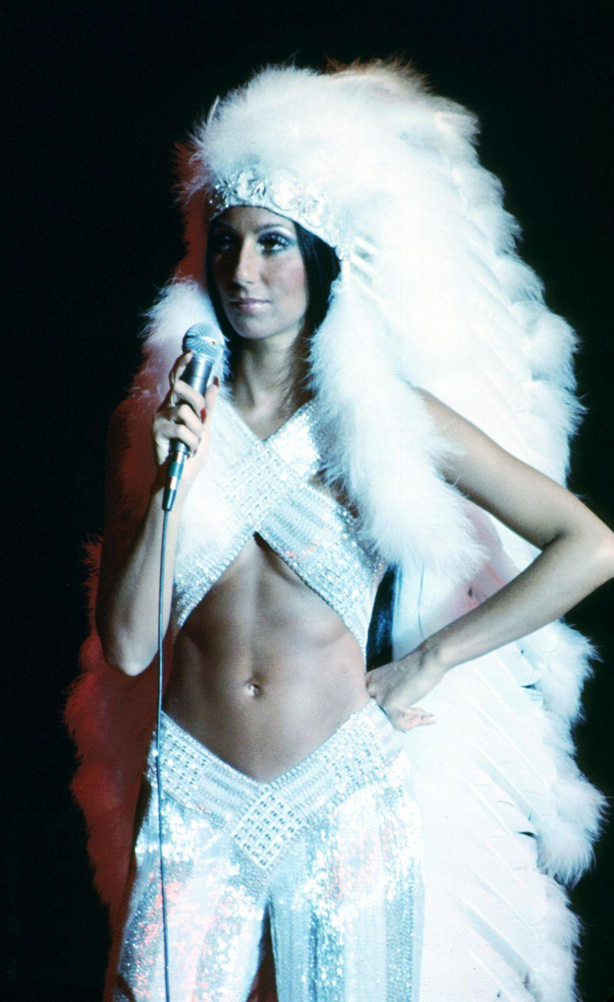 <p>Performing in a feathered headdress and sequined two-piece look. </p>