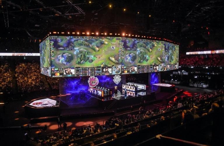 Team Europe (right) and Chinese team FPX (left) compete in the 2019 League of Legends world final in Paris. This year's event will be held later this month in Shanghai, bucking a grim trend of cancellations because of the coronavirus pandemic