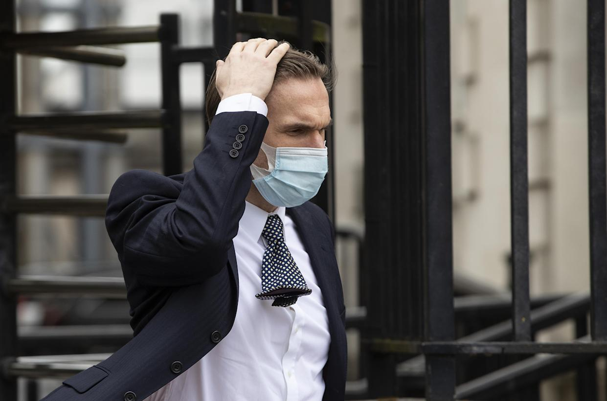 Television presenter Dr Christian Jessen leaves Belfast High Court as defamation proceedings taken against him by First Minister Arlene Foster continue. Picture date: Friday May 21, 2021.