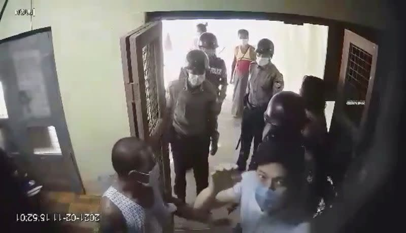 Dr Pyae Phyo Naing (in face mask, lower right) is seen as he is detained by police at his clinic in the Irrawaddy delta region