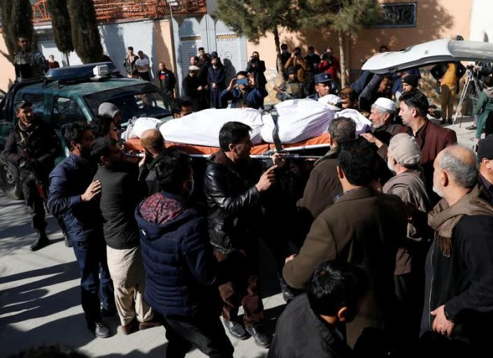 Relatives carry the body of one of the female judges shot dead by unknown gunmen in Kabul