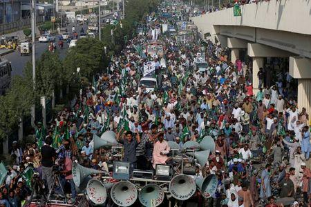 FILE PHOTO: Supporters of the Tehrik-e-Labaik Pakistan (TLP) Islamist political party chant slogans as they march to welcome their leader Khadim Hussain Rizvi (not pictured) during a campaign rally ahead of general elections in Karachi, Pakistan July 1, 2018. REUTERS/Akhtar Soomro/File Photo