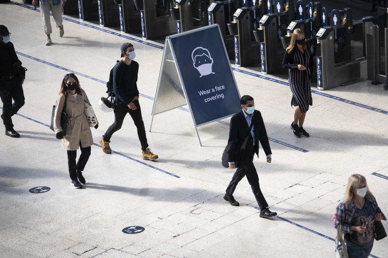 Passengers wearing face masks at Waterloo station in London as face coverings become mandatory on public transport in England with the easing of further lockdown restrictions during the coronavirus pandemic.