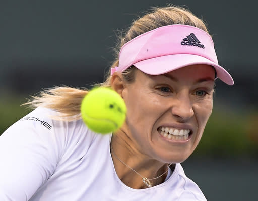 Angelique Kerber, of Germany, hits a return to Venus Williams, of the United States, at the BNP Paribas Open tennis tournament Thursday, March 14, 2019, in Indian Wells, Calif. (AP Photo/Mark J. Terrill)
