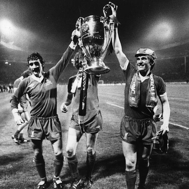 <span>McDermott lifts the European Cup trophy after winning it with Liverpool in 1978</span> <span>Credit: Hulton Archive </span>