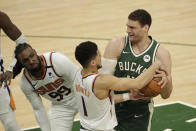 Milwaukee Bucks' Brook Lopez drives to the basket against Phoenix Suns' Devin Booker (1) and Jae Crowder (99) during the second half of Game 3 of basketball's NBA Finals, Sunday, July 11, 2021, in Milwaukee. (AP Photo/Aaron Gash)