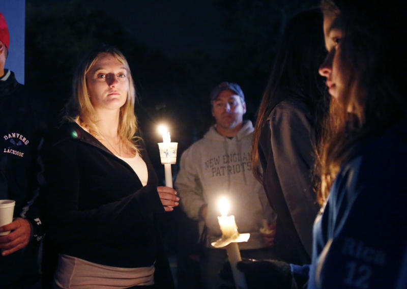 Parents and Danvers High School students hold a candlelight vigil to mourn the death of Colleen Ritzer, a 24-year-old math teacher at Danvers High School, on Wednesday, Oct 23, 2013, in Danvers, Mass. Ritzer's body was found in woods behind the high school, and Danvers High School student Philip Chism, 14, who was found walking along a state highway overnight, was charged with killing her. (AP Photo/Bizuayehu Tesfaye)