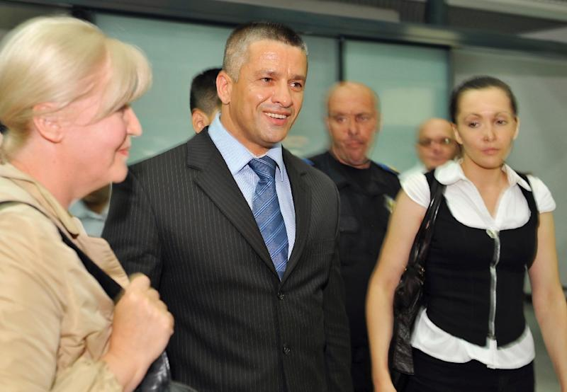 Former commander of Bosnian Muslim forces in Srebrenica Naser Oric (C), pictured on July 4, 2008, called on international justices to order Bosnia to drop war crimes charges against him