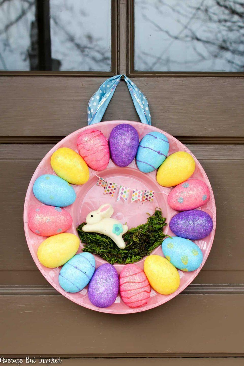 """<p>You'll undoubtedly be using a lot of egg trays for <a href=""""https://www.thepioneerwoman.com/food-cooking/recipes/a35566272/herbed-deviled-eggs-recipe/"""" rel=""""nofollow noopener"""" target=""""_blank"""" data-ylk=""""slk:deviled eggs"""" class=""""link rapid-noclick-resp"""">deviled eggs</a> this Easter, but who knew that they could also be used to craft a unique Easter wreath? With fun festive touches, everyone will ask how you made it.</p><p><strong>Get the tutorial at <a href=""""https://averageinspired.com/2017/03/how-to-make-an-egg-tray-wreath-for-easter-with-dollar-store-supplies.html"""" rel=""""nofollow noopener"""" target=""""_blank"""" data-ylk=""""slk:Average But Inspired"""" class=""""link rapid-noclick-resp"""">Average But Inspired</a>.</strong></p><p><a class=""""link rapid-noclick-resp"""" href=""""https://go.redirectingat.com?id=74968X1596630&url=https%3A%2F%2Fwww.walmart.com%2Fip%2FDeviled-Egg-Clear-Plastic-Crystal-Cut-Platter-Set-of-3-9-in-diameter-Flower-Shaped-12-Egg-Tray%2F297267836&sref=https%3A%2F%2Fwww.thepioneerwoman.com%2Fhome-lifestyle%2Fcrafts-diy%2Fg35698457%2Fdiy-easter-wreath-ideas%2F"""" rel=""""nofollow noopener"""" target=""""_blank"""" data-ylk=""""slk:SHOP EGG TRAYS"""">SHOP EGG TRAYS</a></p>"""