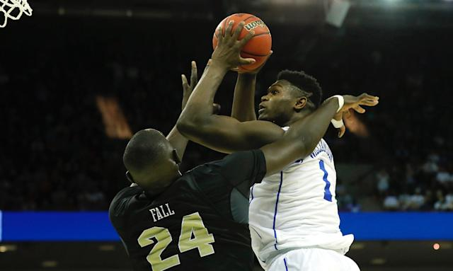 He didn't get his dunk, but Zion Williamson's layup on Tacko Fall saved Duke from a stunning 2nd-round upset. (Getty