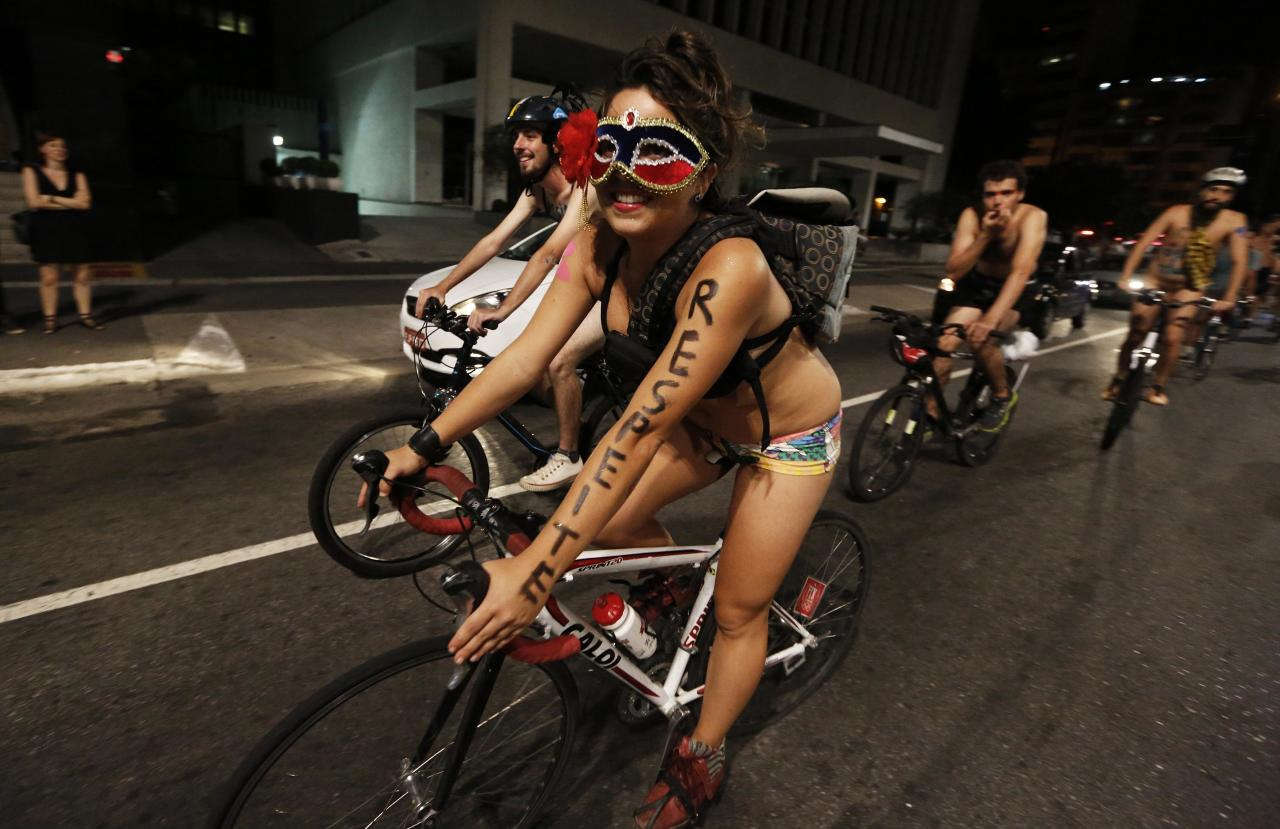 """Cyclists take part in the """"World Naked Bike Ride"""" on Sao Paulo's Paulista Avenue March 15, 2014. The event aims to defend the right of cyclists to ride on the streets in safety, according to organisers. The word on the woman's arm reads, """" Respect"""". REUTERS/Nacho Doce (BRAZIL - Tags: SOCIETY SPORT CYCLING TRANSPORT)"""